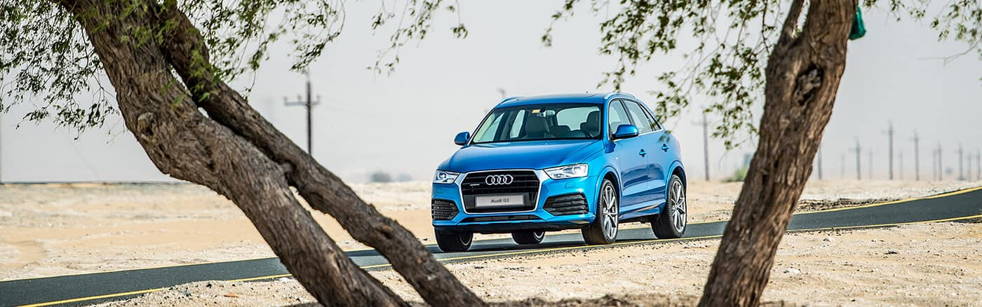 Q3_audi_suv_blue_front_angle_trees_1400x438.jpg